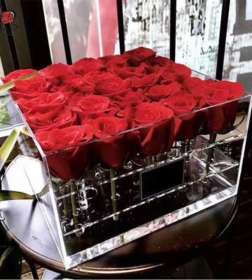 19 роз в прозрачной коробке